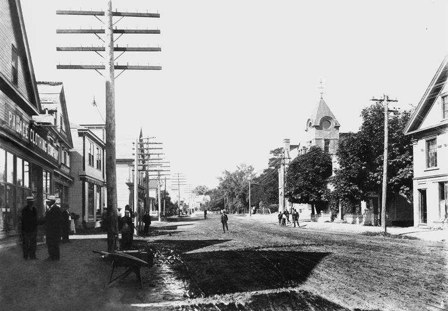 B12 - Palace Clothing Company and T. J. Bonner on Main Street, c 1900