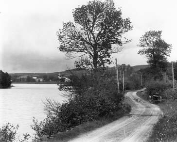 Lochaber Lake c dirt road side 1916 Notman photo Chisholms idland on left
